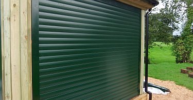 Dark green K77 foam filled roller shutter