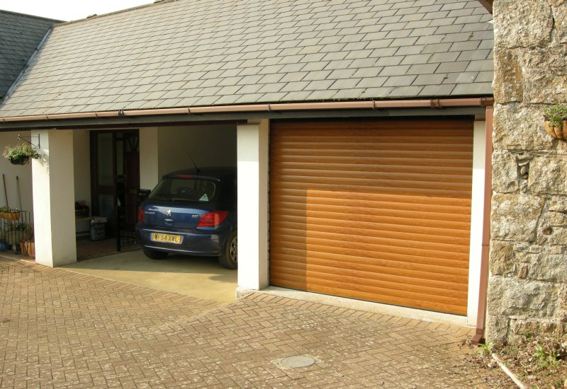 Garage door roller shutter with a blue car