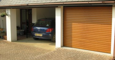 car parked in garage with insulated aluminium roller shutter door