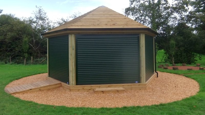 Set of green roller shutters on a gazebo