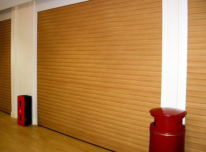 Foam filled aluminium roller shutters with a wood effect finish applied to the outside