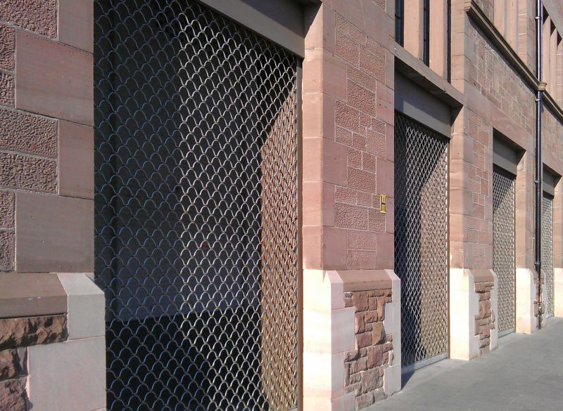 Roller grilles protecting office street entries