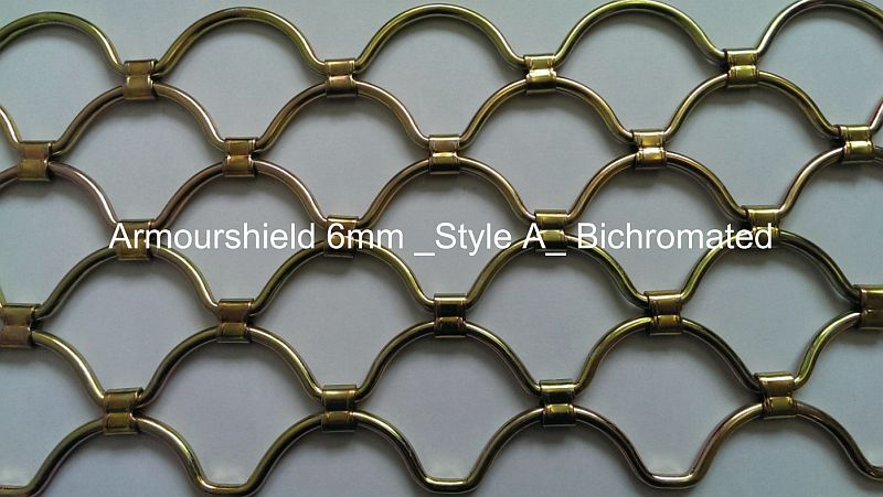 Detail of an armourshield roller grille curtain in a gold finish.