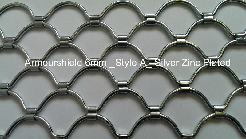 Detail of an armourshield roller grille curtain in a silver finish