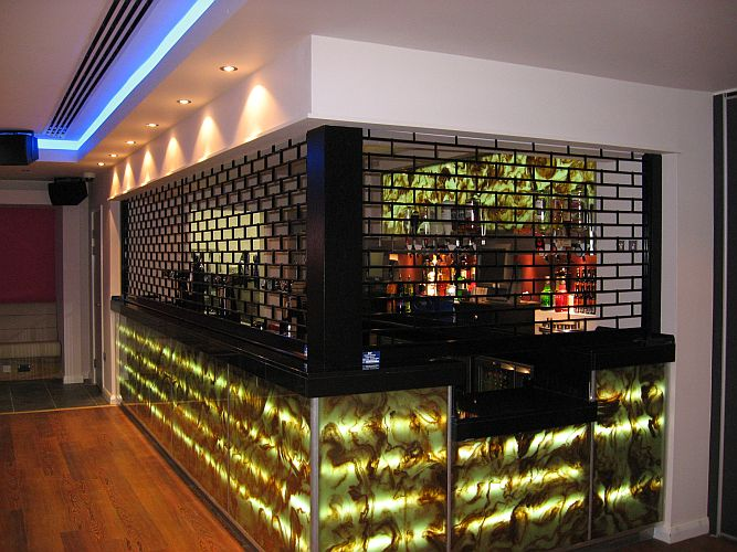 90 Degree corner bar with roller grille.