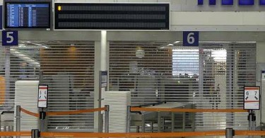 Clearlook roller shutters installed in front of an airport security area.