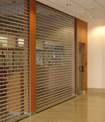 A pair of transparent clearlook roller shutters installed at a bank.