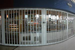Curved sliding security shutter.