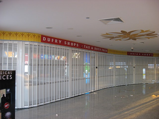 Curved sliding shutter at an airport