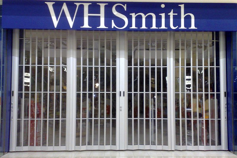 Sliding security shutter at a WH Smith shopfront.