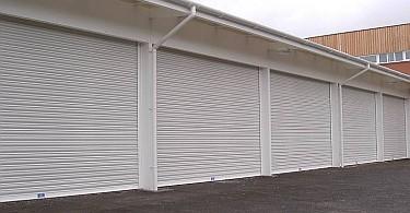 Row of industrial security roller shutters.