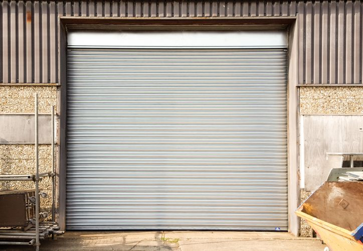Galvanised steel industrial quality roller shutter at the back of a factory