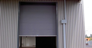 High overhead sectional door to goods entrance.