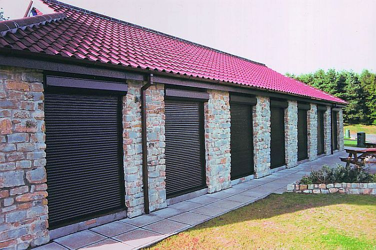 Roller shutters at a row of garage storage blocks.
