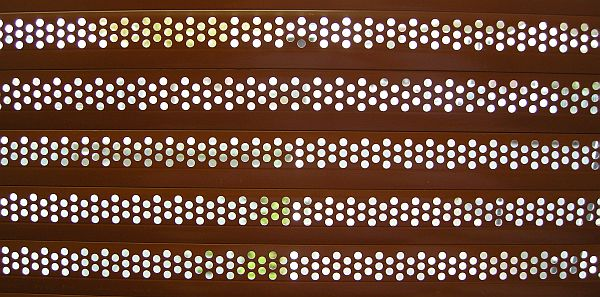 Detail of an aluminium roller shutter curtain with perforations