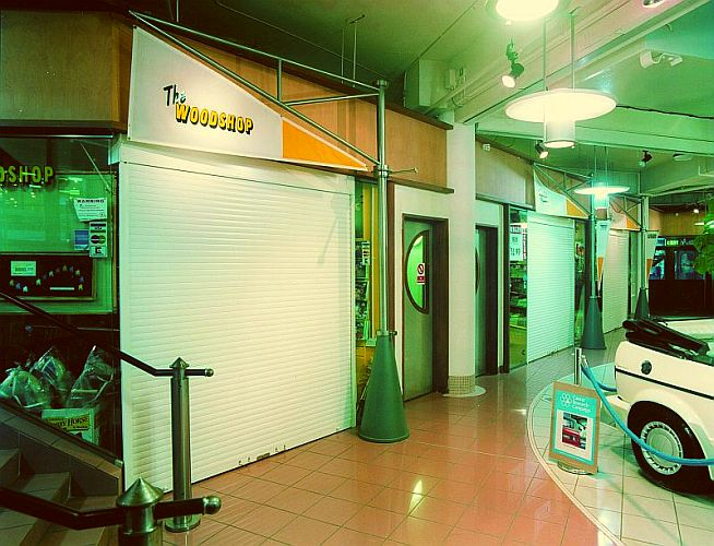Roller shutters at individual shopping units.