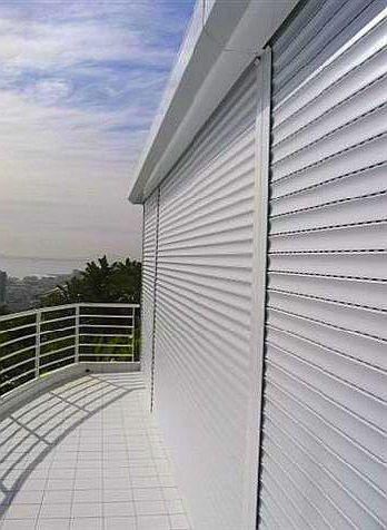 Aluminium roller shutters with vented lath over balcony balcony doors.