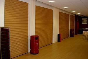 Four roller shutters in a row as a room division.