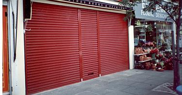 Screenguard security roller shutter over a shop-front.