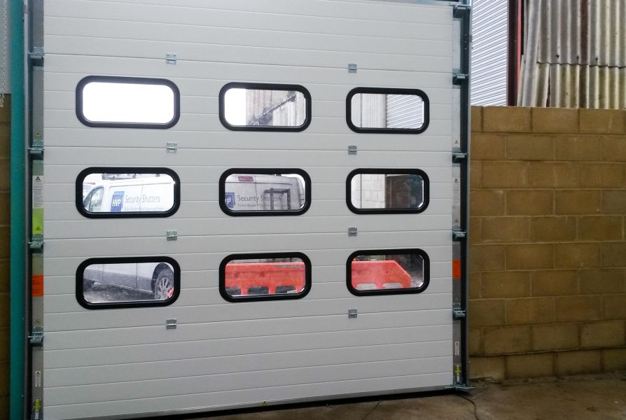 Internal view of a sectional door with clear rounded viewpanels