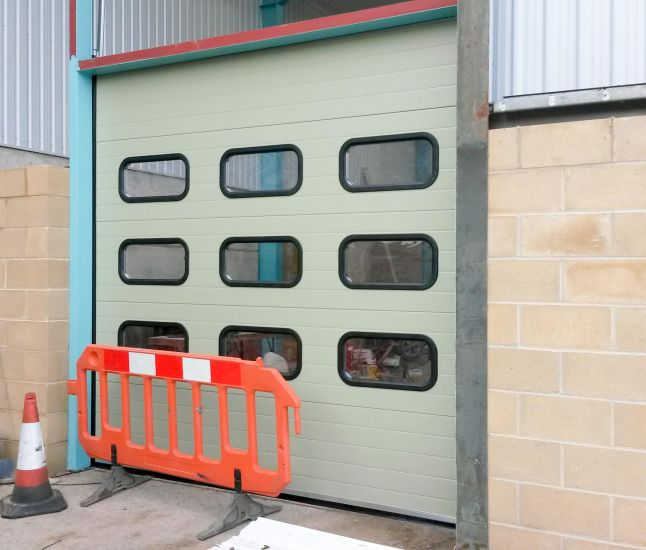 External view of a sectional door with clear rounded viewpanels