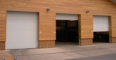 Factory with three sectional overhead doors.