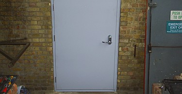 A new security door installed in the opening that used to house an emergency exit door.