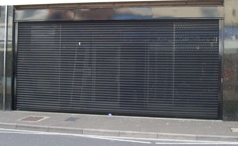 Shopfront viewguard roller shutter in daylight.